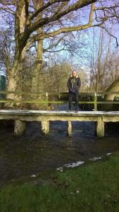 A footbridge that could easily be neolithic, not to mention its occupant. :)