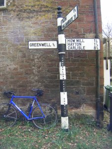 Plus a reminder of the last long winter ride. great to see these traditional signposts being renovated all over the place up here.