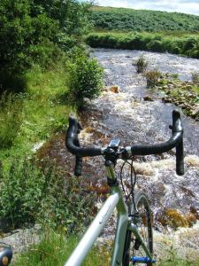 Hilton Beck at Deep Gill, Cumbria, the water the colour of tea after a night of heavy rain in the peaty fells.