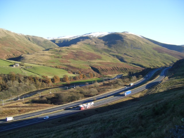 M6, West Coast main line and Howgill Fells from Grayrigg Hause. The Fairmile Road's in there too, if you know where to look.