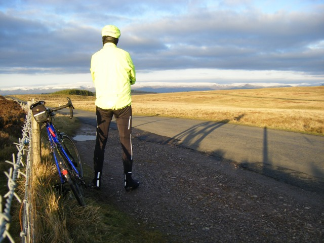 Contemplating snow-capped Pennines from Orton Scar.
